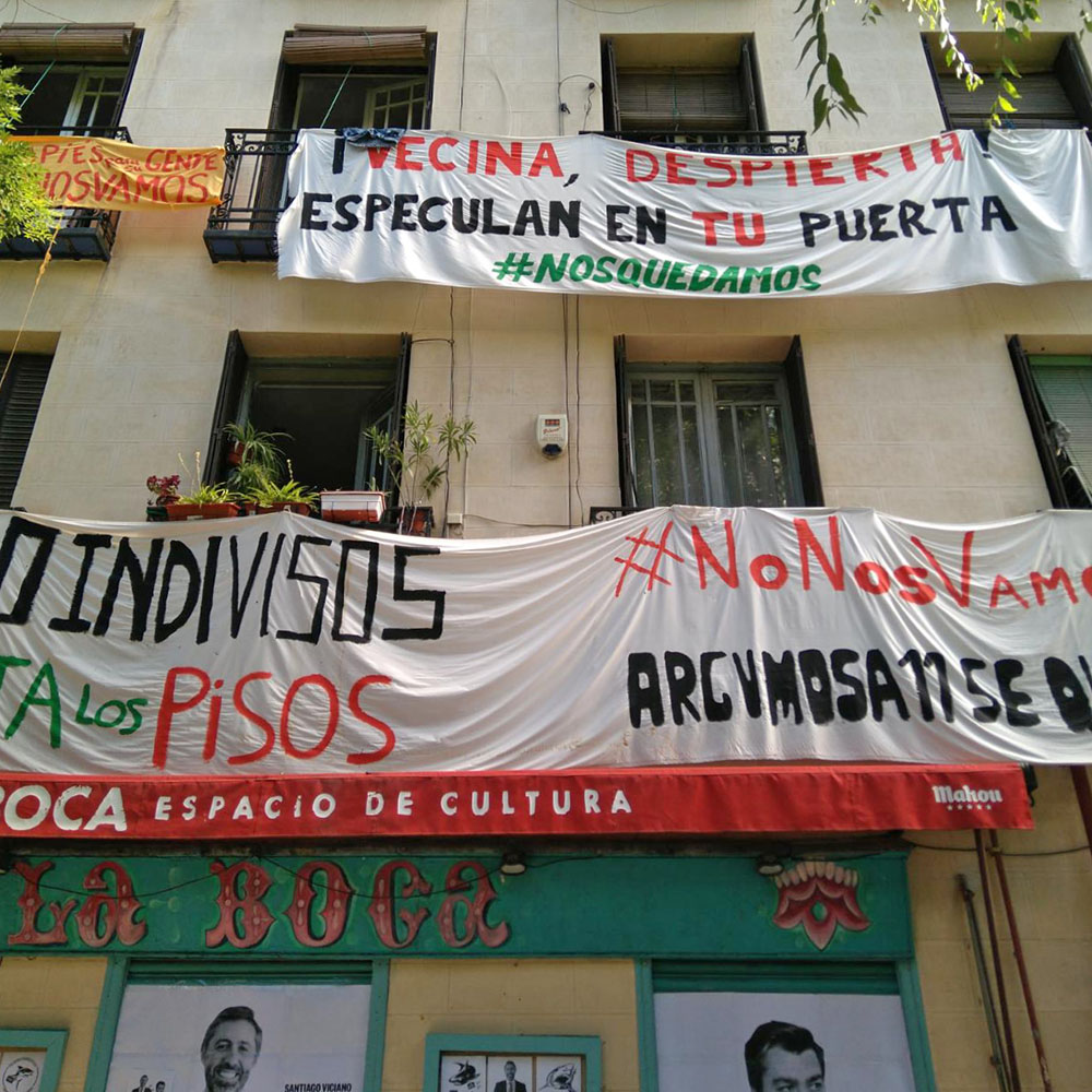 Building covered with anti-eviction banners.