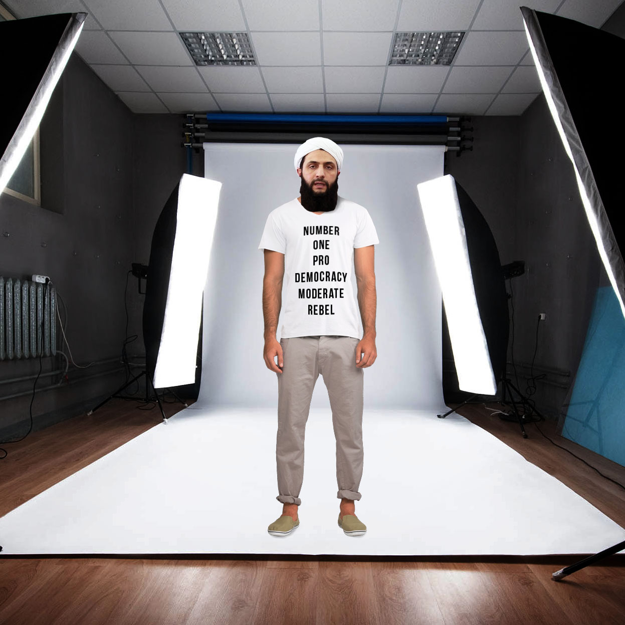 "Leader of Al-Nusra in Syria as a clothing model in a studio wearing a ""Number one pro democracy moderate rebel"" t-shirt."