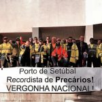 Dockers of the port of Setúbal displaying banner against precarious work in the port.
